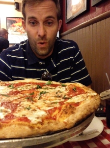 The man loves his pizza.