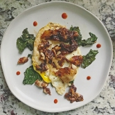Sautéed Kale w/Fried Egg, Crispy Chicken Skins & Sriracha